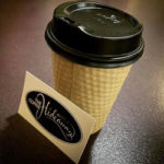 A photo of a take away coffee from The Coffee Hideaway